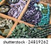 Semi precious gemstone beads in a wooden display case - stock photo