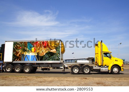 Semi trailer delivering christmas goods. Original  photo on trailer by photographer - stock photo