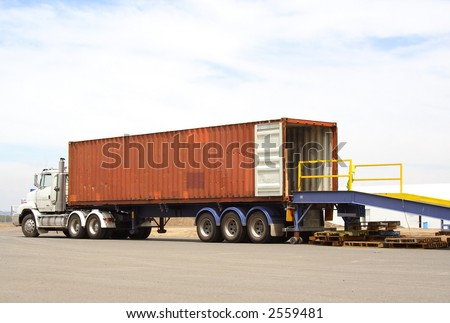 Semi truck backed onto loading dock - stock photo