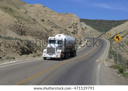 SEMI TRUCK DRIVING ON HIGHWAY, BAJA, MEXICO - January 20, 2016: Semi truck going fast on the desert mountain highway