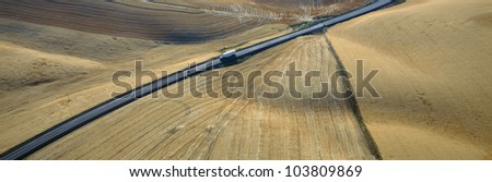 Semi-Truck driving through Wheat Fields, S.E. Washington - stock photo