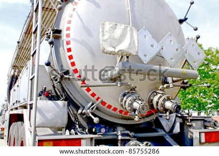 semi truck for fuel and oil transport with warning plates - stock photo