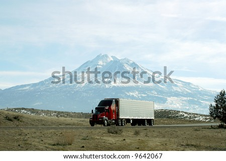 Semi truck going fast on interstate highway with Mt Shasta behind, California - stock photo