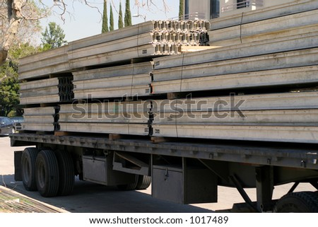 Semi truck hauling a load - stock photo
