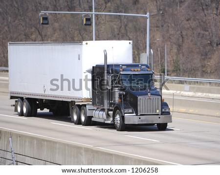 Semi Truck on an Overpass on the Highway - stock photo