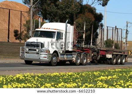 Semi truck on road - stock photo