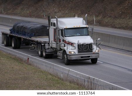 Semi Truck on the High way with Space for Copy - stock photo