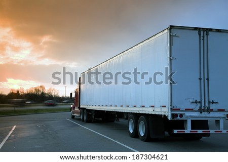 Semi Truck Parked on rest area. Sunset time - tobacco graduated filter used. - stock photo