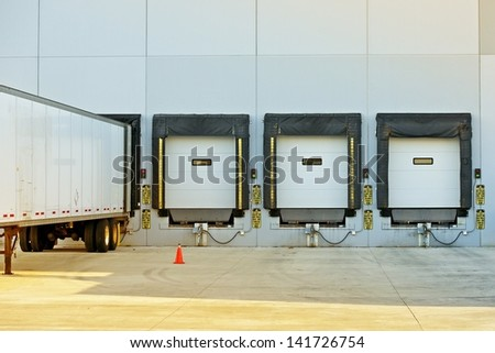 Semi Truck Trailer Warehouse Loading / Unloading. Large Modern American Warehouse Building. Shipping and Cargo Photo Collection.