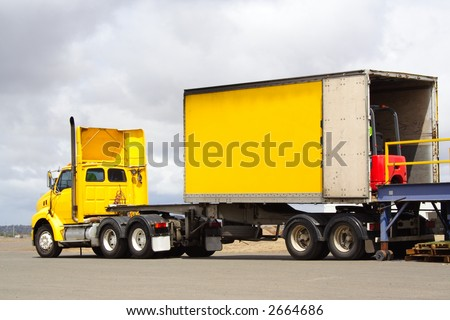 Semi truck with forklift in back - stock photo