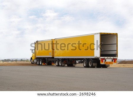 Semi truck with 2 trailers - stock photo