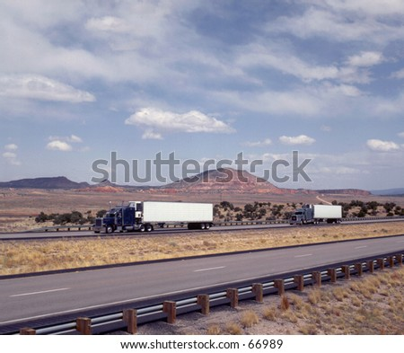 Semi-trucks on interstate - stock photo