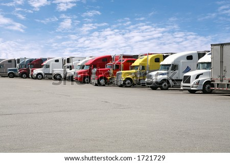 Semi trucks parked together - stock photo