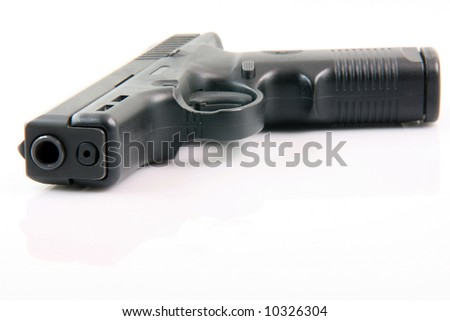 semiautomatic handgun isolated on white background with small reflection