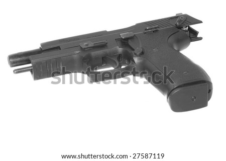 Semiautomatic handgun with slide back, isolated on a white background