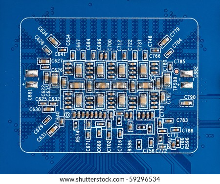 semiconductor components on a blue background - stock photo