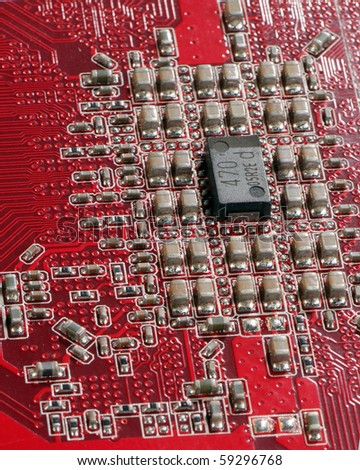 semiconductor components on a red background - stock photo