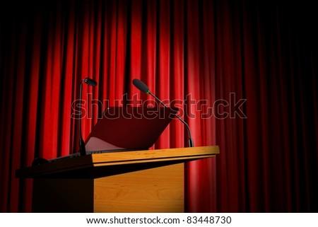 Seminar podium and red curtain - stock photo