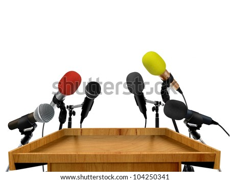 Seminar speech podium and microphones - stock photo