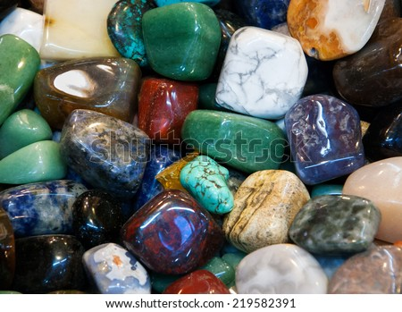 Semiprecious gemstones for sale at flea market. - stock photo