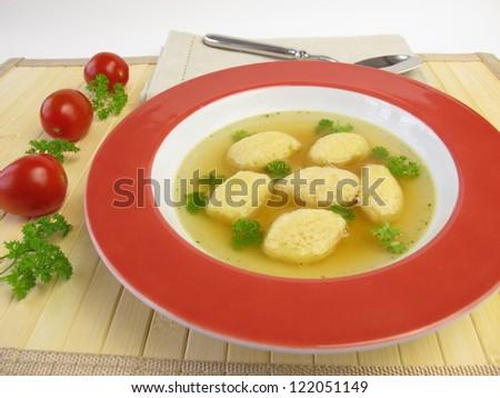 Semolina dumplings soup - stock photo