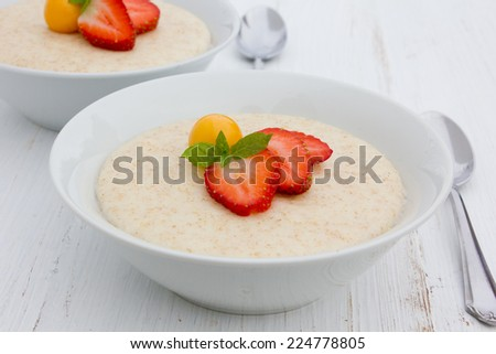 Semolina porridge with strawberries and gooseberry/Semolina porridge/food - stock photo