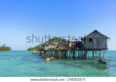 SEMPORNA, MALAYSIA - JULY 01 : Unidentified sea gypsy family in their house on July 01, 2012 in Semporna, Sabah, Malaysia. Sea gypsies is an indigenous ethnic group in Sabah, Malaysia. - stock photo
