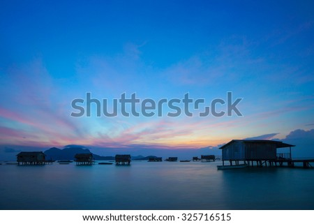 SEMPORNA, MALAYSIA - 21ST SEPTEMBER 2013; Sunrise over Maiga island in Sabah, Malaysia. Maiga is a small island in the Tun Sakaran Marine Park, located 16km north of Semporna.