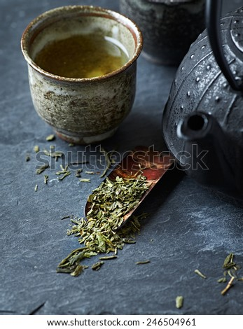 Sencha leaves on a sakura (cherry bark) tea spoon - stock photo