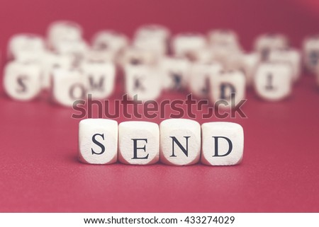 Send word written on wood cube with red background - stock photo
