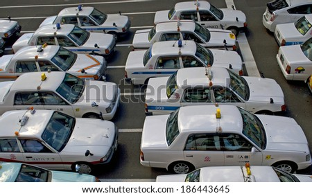 SENDAI, JAPAN - APRIL 5: Taxis stand at April 5, 2014 in Sendai, Japan. Taxis are the most popular way to get around the cities in rural Japan. They are punctual, honest and plenty.