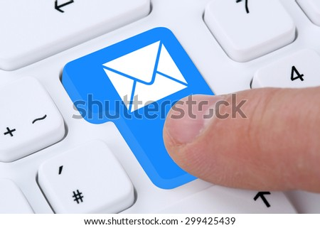 Sending E-Mail email mail message on computer keyboard with letter symbol - stock photo
