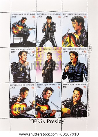 SENEGAL - CIRCA 1998: A stamp printed in Senegal shows the famous Elvis Presley, series, circa 1998 - stock photo