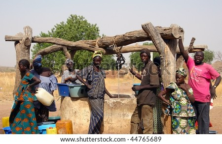 SENEGAL - FEBRUARY 13: All the people working in the extraction of water from the well in the Peul ethnic village on February 13, 2007 near Wassadou, Senegal. - stock photo