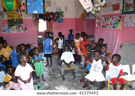 SENEGAL - FEBRUARY 19: Child Carabane Island have a school with the help of French NGOs and donations from tourists on February 19, 2007 in Carabane, Casamance, Senegal. - stock photo
