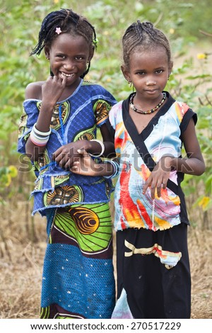 SENEGAL, Ferlo reserve, November, 2 2013: young girls in traditional outfit on the way to school. - stock photo