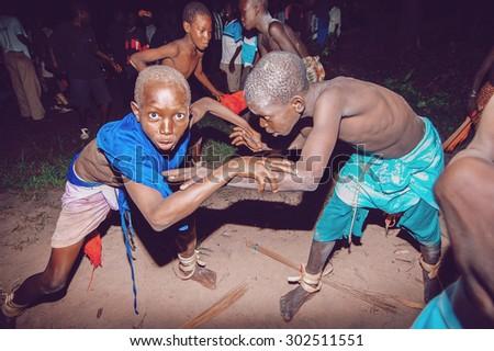 SENEGAL - SEPTEMBER 19: Kids in the traditional struggle (wrestle) clothes of Senegal, September 19, 2007 in Casamance, Senegal  - stock photo
