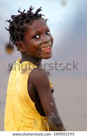 SENEGAL - SEPTEMBER 17: Little girl from the island of Carabane smiling to camera, on September 17, 2007 in Carabane, Casamance, Senegal - stock photo