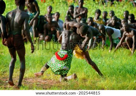 SENEGAL - SEPTEMBER 19: Men in the traditional struggle (wrestle) of Senegal, September 19, 2007 in Casamance, Senegal  - stock photo