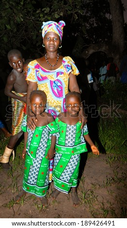 SENEGAL - SEPTEMBER 19: Mother and her twin daughters posing for the camera, on September 19, 2007 in Casamance, Senegal. - stock photo