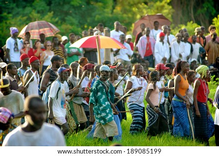 SENEGAL - SEPTEMBER 19: Spectators watching the traditional struggle (wrestle) of Senegal, September 19, 2007 in Casamance, Senegal