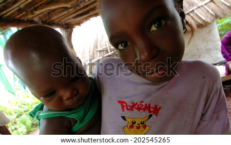SENEGAL - SEPTEMBER 17: Unidentified girl and baby from the Bedic ethnicity, the Bedic living on the margins of society on top of a hill, on September 17, 2007 in Country Bassari, Senegal  - stock photo