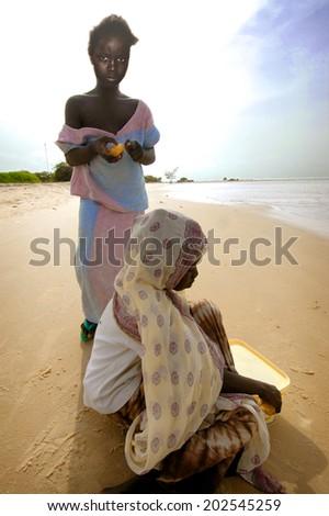 SENEGAL - SEPTEMBER 16: unidentified girls from the island of Carabane posing, September 16, 2007 in Carabane, Casamance, Senegal - stock photo
