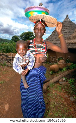 SENEGAL - SEPTEMBER 11: Woman charged with child Bedic, the Bedic living on the margins of society on top of a hill, September 11, 2007 in Country Bassari, Senegal - stock photo