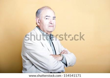 Senior adult man folding his arms - stock photo