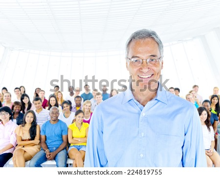 Senior adult smiling and standing out from crowd - stock photo