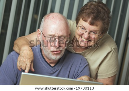 Senior Adults on Working on a Laptop Computer - stock photo