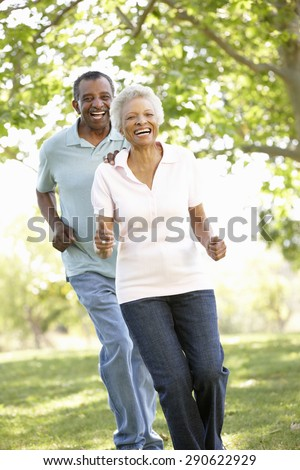 Senior African American Couple Running In Park - stock photo