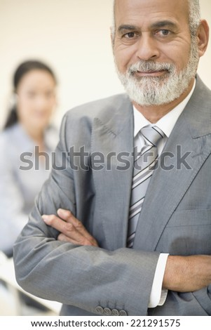 Senior African businessman with arms crossed