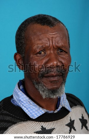 Senior African man with beard and sad expression - stock photo